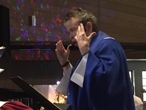 Rev Ruth Jensen-Forbell Directing the Christmas Cantata at Cornerstone MCC